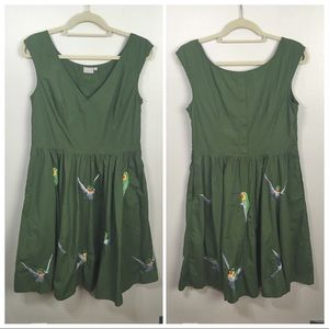 Eshakti army green dress with embroidered birds.